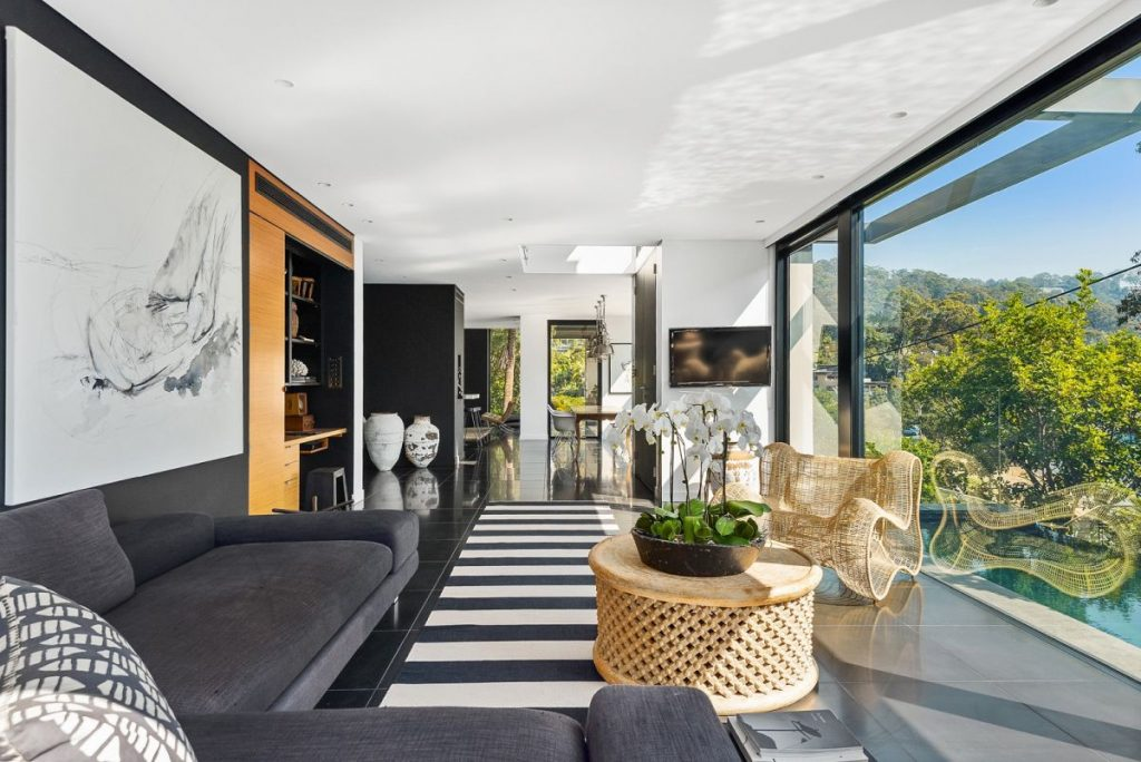 Black and white living room with beautiful view