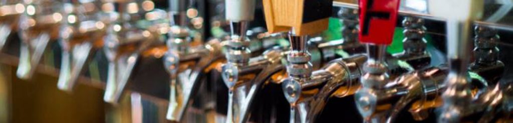 a close up of beer taps at a restaurant in high point nc